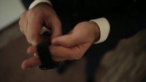 Groom wears a black jacket watches stock video footage