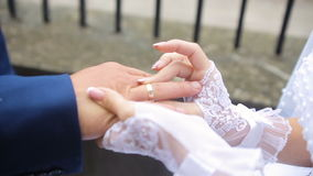 Groom wears on the bride's finger a ring. HD stock video