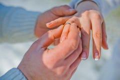 Groom wears bride a wedding ring Royalty Free Stock Photos