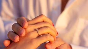 Groom wears gold ring bride. stock footage