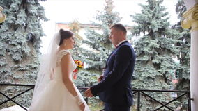 Groom wears gold ring bride stock video