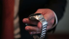 Groom wears his watch close up stock video footage