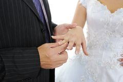 Groom wears the ring bride Stock Images