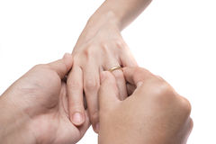 The groom wears the ring to bride on white background isolate Stock Images