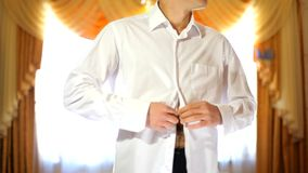 Groom Wears A Shirt stock footage