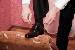 Groom wears wedding shoes. The groom wears wedding shoes Stock Photos