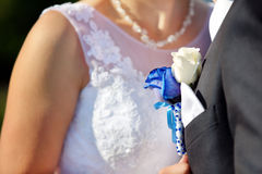 Groom with wedding blue rose buttonhole outdoors Stock Image