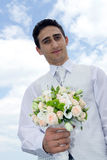 Groom with wedding bouquet. Young groom with wedding bouquet stock photos