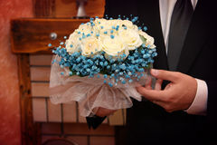 Groom with wedding bouquet Stock Photo