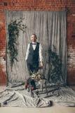 Groom. Wedding in European style, beautiful bride and groom in the Studio Royalty Free Stock Photo