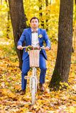 Groom wedding portrait with white bike Stock Images