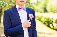 Groom in the wedding suit stock images