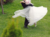 Groom Whirling Bride Royalty Free Stock Image