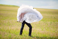 Groom Whirling Bride Stock Photo