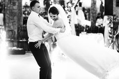 Groom whirls a bride while dancing the very first time Stock Image