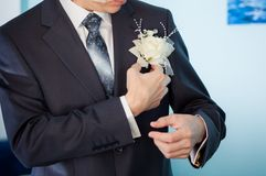 Groom white boutonniere Stock Photo
