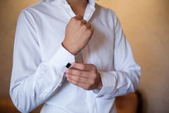 Groom in a white shirt dress cufflinks Stock Images