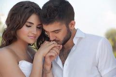 Groom in white shirt kiss bride hand. Very gentle Stock Image
