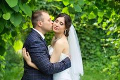 Groom in white shirt kissing bride hand. Very gentle photo Stock Photo