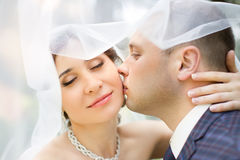 Groom in white shirt kissing bride hand. Very gentle photo Royalty Free Stock Photos