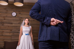 Free Groom With Crosses Fingers Makes Promise To Bride Royalty Free Stock Images - 88288679