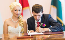 Groom  write on registration of marriage Royalty Free Stock Photos