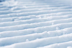 Groomed empty ski track, corduroy snow texture Stock Images