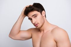 Groomed pamper virile hazel eyes people person remedy moisturizing concept. Close up portrait of handsome confident attractive mu. Scular naked nude guy fixing royalty free stock photos