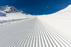 Groomed ski piste Stock Images