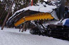 Groomer de pente de ski Photos stock