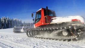 Groomer in motion on a snowy meadow Royalty Free Stock Photos
