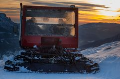 Groomer. Snow groomer while he beats the ski track Royalty Free Stock Photo