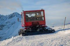 Groomer. Snow groomer while he beats the ski track Stock Photo