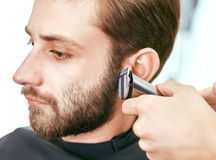 Grooming the beard. Barbershop Royalty Free Stock Photography