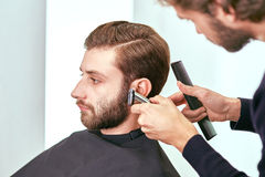 Grooming the beard. Barbershop Stock Photography