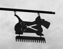 Grooming dog sign. With scissors Royalty Free Stock Photography