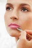 Grooming eyebrows with eyebrow brush Royalty Free Stock Image
