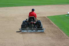 Grooming the Infield at Hammond Stadium. Baseball infields must be groomed to protect player safety and to create a level playing field for both of the teams stock photos