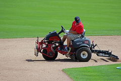 Grooming the Infield at Hammond Stadium. Baseball infields must be groomed to protect player safety and to create a level playing field for both of the teams royalty free stock photo