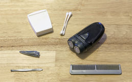 Grooming items on wooden table. Several grooming items on a wooden table Stock Photography