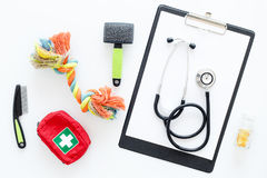 Grooming set with pets cure tools and stethoscope on white background top view Stock Photos