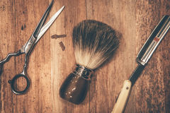 Grooming tools. Top view of barbershop tools lying on the wood grain Royalty Free Stock Image