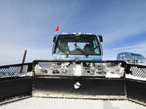 Grooming Tractor. Snowplow at the top of Vail ski resort, Colorado stock image