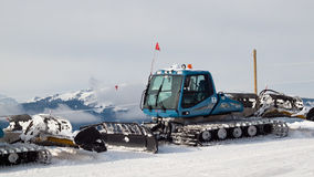 Grooming Tractor. Snowplow at the top of Vail ski resort, Colorado royalty free stock photography