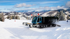 Grooming Tractor. Snowplow at the top of Vail ski resort, Colorado stock photos