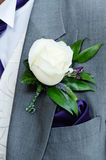 Grooms buttonhole closeup Stock Images
