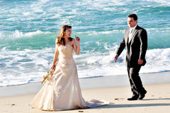 Grooms couple. Playing on the beach Royalty Free Stock Photos