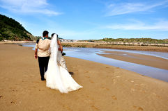 Grooms couple on the beach Stock Photo
