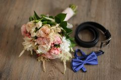 Grooms morning details composition on the floor Royalty Free Stock Photos