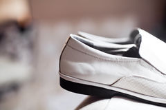 Grooms shoes. On chair closeup Stock Photos